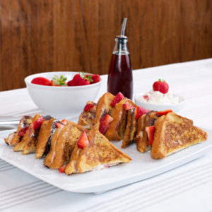 Platter with strawberry stuffed french toast