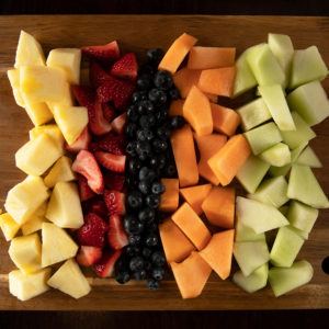 fresh cut fruit including pineapple, melon, and strawberries